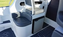 Extreme curved seating module with fridge